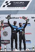 #10: Konica Minolta Acura ARX-05 Acura DPi, DPi: Ricky Taylor, Filipe Albuquerque,  celebrate the win in victory lane on the podium