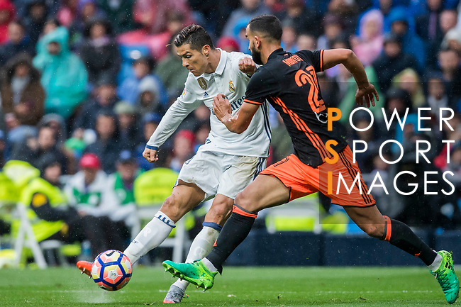 Cristiano Ronaldo (l) of Real Madrid vies for the ball with Martin Montoya Torralbo of Valencia CF  during their La Liga match between Real Madrid and Valencia CF at the Santiago Bernabeu Stadium on 29 April 2017 in Madrid, Spain. Photo by Diego Gonzalez Souto / Power Sport Images