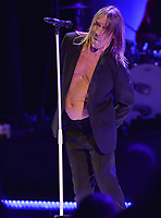 MIAMI BEACH, FL - APRIL 19: Iggy Pop is joined onstage by Eagles of Death Metal (Paris Bombing) guitar player Josh Homme  at the Fillmore Miami Beach two days before his 69th Birthday. James Newell Osterberg, Jr., better known by the stage name Iggy Pop, is an American singer-songwriter, musician and actor who's birthday is on April 21, 1947 (age 68)  on April 19, 2016 in Miam Beach, Florida.<br /> <br /> <br /> People:  Iggy Pop<br /> <br /> Transmission Ref:  FLXX<br /> <br /> Must call if interested<br /> Michael Storms<br /> Storms Media Group Inc.<br /> 305-632-3400 - Cell<br /> 305-513-5783 - Fax<br /> MikeStorm@aol.com<br /> www.StormsMediaGroup.com