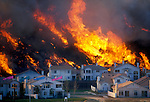 A raging brush fire threatens new homes in San Diego's Carmel Valley neighborhood in north San Diego County.