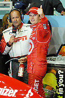 """LAS VEGAS, NV - OCTOBER 16:L   (AP) –Indianapolis 500 winner Dan Wheldon died Sunday in a fiery 15-car wreck at Las Vegas Motor Speedway when his car flew over another on Lap 13 and smashed into the wall just outside turn 2.<br /> <br /> Wheldon was 33. Drivers were told of Wheldon's death in a meeting about two hours after the fiery, smoky crash that many drivers said was the worst they had ever seen.<br /> <br /> He won the Indianapolis 500 twice, including this year.<br /> <br /> """"IndyCar is very sad to announce that Dan Wheldon has passed away from unsurvivable injuries,"""" IndyCar CEO Randy Bernard said. """"Our thoughts and prayers are with his family today. IndyCar, its drivers and owners, have decided to end the race. In honor of Dan Wheldon, the drivers have decided to do a five-lap salute to in his honor.""""<br /> <br /> Three other drivers, including championship contender Will Power, were hurt in the pileup.<br /> <br /> The wreck left Townsend Bell upside down and smoldering cars and debris littered the track nearly halfway up the straightaway of the 1.5-mile oval.<br /> <br /> The track was red-flagged following the accidents while crews worked on fences and removed smashed cars.<br /> <br /> Wheldon started in the back of the pack but quickly worked his way through the 34-car field before the wreck.<br /> <br /> """"It was like a movie scene which they try to make as gnarly as possible,"""" said Danica Patrick, making her final IndyCar start. """"It was debris everywhere across the whole track, you could smell the smoke, you could see the billowing smoke on the back straight from the car. There was a chunk of fire that we were driving around. You could see cars scattered.<br /> <br /> Drivers had been concerned about the high speeds at the track, where they were hitting nearly 225 mph during practice.<br /> <br /> Their concerns became reality when contact on Turn 2 sent cars flying through the air, crashing into each other and into the outside wall and catch fence.<"""