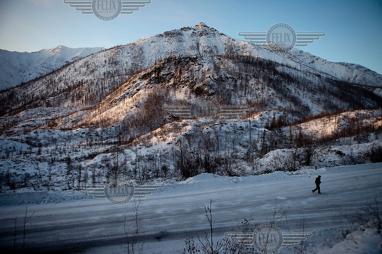 A man walks on the Kolyma Highway leading through the Verkhoyansk mountain range, in one of the coldest inhabited areas on earth.