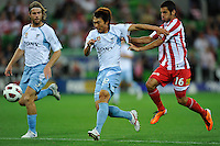 MELBOURNE, AUSTRALIA - FEBRUARY 12: Sung Hwan Byun of Sydney FC and Aziz Behich of the Heart context the ball in the round 27 A-League match between the Melbourne Heart and Sydney FC at AAMI Park on February 12, 2011 in Melbourne, Australia. (Photo Sydney Low / AsteriskImages.com)