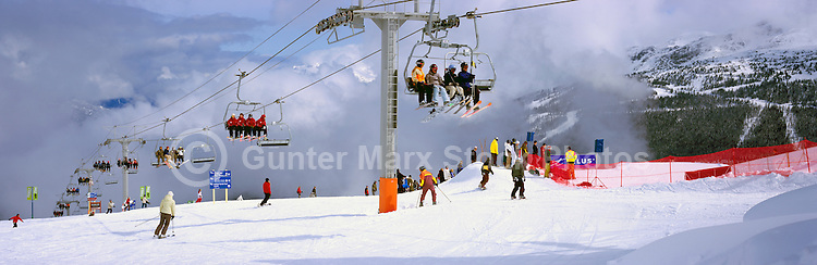 Skiers and Snowboarders on Chair Lift, Downhill Skiing and Snowboarding on Whistler Mountain, Whistler Ski Resort, BC, British Columbia, Canada - Panoramic View