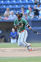 Greensboro Grasshoppers third baseman Marcos Rivera (11) swings at a pitch during a game against the Asheville Tourists at McCormick Field on May 10, 2018 in Asheville, North Carolina. The Tourists defeated the Grasshoppers 14-10. (Tony Farlow/Four Seam Images)
