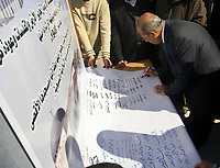 "Palestinian Parlamentary members are seen on a declaration against the upcoming U.S.-hosted Annapolis summit outside the parliament in Gaza City, Monday, Nov. 26, 2007. The Islamic Hamas rulers of Gaza stepped up their verbal attacks on Palestinian President Mahmoud Abbas on Monday ahead of a U.S.-hosted Mideast conference, saying his policies had failed and undermined prospects for Palestinian statehood and unity. ""photo  by Fady Adwan"""