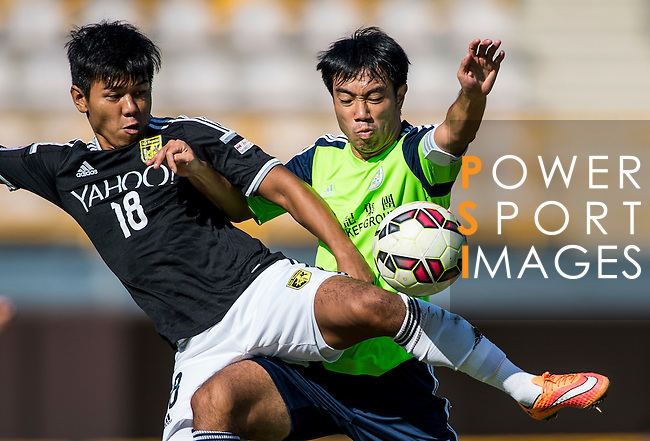 Kwok Keung Sham of Sun Pegasus FC (L) competes for the ball with Ngai Tong Lam of Wofoo Tai Po (R) during the HKFA Premier League between Wofoo Tai Po vs Sun Pegasus at the Tai Po Sports Ground on 22 November 2014 in Hong Kong, China. Photo by Aitor Alcalde / Power Sport Images