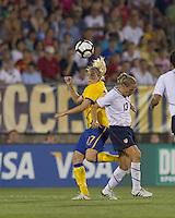 Sweden midfielder Lisa Dahlkvist (17) and US midfielder Kristine Lilly (13) battle for head ball. The US Women's national team beat Sweden, 3-0, at Rentschler Field on July 17, 2010.
