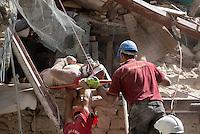 Operators rescue an injured from rubble of collapsed building in the village of Amatrice, central Italy, hit by a magnitude 6 earthquake at 3,36 am, 24 August 2016.<br /> Operatori recuperano un ferito tra le macerie degli edifici crollati dopo il terremoto che alle 3,36 del mattino ha colpito Amatrice, 24 agosto 2016.<br /> UPDATE IMAGES PRESS/Riccardo De Luca