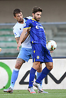 Francesco Acerbi of SS Lazio and Fabio Borini of Hellas Verona compete for the ball during the Serie A football match between Hellas Verona and SS Lazio at stadio Marcantonio Bentegodi in Verona (Italy), July 26th, 2020. Play resumes behind closed doors following the outbreak of the coronavirus disease. <br /> Photo Daniele Buffa / Image Sport / Insidefoto