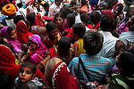 Crowd on the road to Pushkar fair ground on the final day of holy dip in Pushkar lake.  Rajasthan, India.