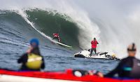 Half Moon Bay, California - January 24, 2014: 2014 Maverick's Invitational Zach Wormhoudt dropping in a small one.