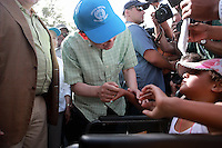 Pictured: Ban Ki-Moon speaks to a disabled migrant girl at Kara Tepe in Lesbos, Greece. Saturday 18 June 2016<br /> Re: The United Nations secretary-general Ban Ki-moon has visited refugee camps on Lesbos island where 3,400 refugees and other migrants live.