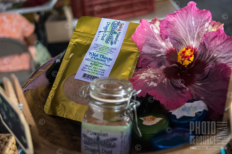 A close-up of Spicy Hawaiian Chocolate Maca Dragon Dust and a pretty hibiscus flower at the Hilo Farmers Market, Big Island of Hawai'i.