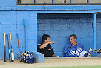 July 22, 2009: J.J. Cooper of Baseball America interviews Burlington Royals RHP Keaton Hayenga (55) in the dugout prior to a game at Burlington Athletic Stadium in Burlington, N.C. Photo by:  Tom Priddy/Four Seam Images