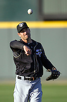 Omaha Storm Chasers first baseman Xavier Nady #21 warms up before the Pacific Coast League baseball game against the Round Rock Express on April 4, 2013 at the Dell Diamond in Round Rock, Texas. Round Rock defeated Omaha in their season opener 3-1. (Andrew Woolley/Four Seam Images).