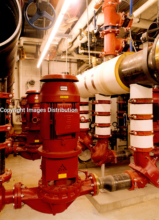 November 2001, Montreal, Quebec, Canada<br /> <br /> Industrial photo<br /> <br /> New pumps (in red) in the mecanic room of<br />  (the old section of)<br />  the Montreal Convention Centre, are used <br /> to circulate hot water to the new section, currently beeing built (Nov 2001) .<br /> <br /> Mandatory Photo Credit ; Copyright 2001 by Pierre Roussel-Images Distribution <br /> <br /> NOTE : scan from 8x10 print of 2 1/4 negative.<br /> Nikon D-1 digital photos also available.