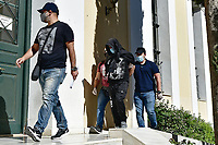 Pictured: A Georgian man (with hooded top), whose name hasn't been released yet, is transferred with police escort to appear before a prosecutor in Athens, Greece. Tuesday 18 May 2021<br /> Re: Murder of Caroline Crouch who was killed in front of her 11 month old daughter after thieves broke into the home she shared with her husband Charalambos (Babis) Anagnostopoulos in Glyka Nera, near Athens, Greece.<br /> The woman, 20, was first tortured and then strangled to death in the raid which began around 5am Tuesday, police said.<br /> Thieves first tied up the woman's husband then went to her room where she was sleeping next to their daughter, tied her up, and killed her.