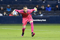 KANSAS CITY, KS - MAY 9: Brad Stuver #41 Austin FC rolls out the ball during a game between Austin FC and Sporting Kansas City at Children's Mercy Park on May 9, 2021 in Kansas City, Kansas.