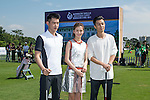 Li Haotong of China and Rynard van Eden of South Africa give a clinic to golfers including Hong Kong model Karena Ng and singer Pakho Chau on the sidelines of World Celebrity Pro-Am 2016 Mission Hills China Golf Tournament on 20 October 2016, in Haikou, China. Photo by Marcio Machado / Power Sport Images