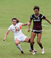 NWA Democrat-Gazette/BEN GOFF @NWABENGOFF<br /> Hannah Neece of Arkansas and Kennadi Carbin of Mississippi State battle for the ball on Sunday Sept. 20, 2015 during the match at Razorback Field in Fayetteville.