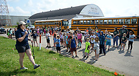 Laci Shuffield, director of the Arkansas Air and Military Museum, speaks Thursday, June 10, 2021, to 118 students from Alma before leading them on a tour of the museum in Fayetteville. The students are participants in Camp Airedale, a three-week summer camp focused on experiences and relationship building for students in the school district that features a field trip each week. Visit nwaonline.com/210611Daily/ for today's photo gallery.<br /> (NWA Democrat-Gazette/Andy Shupe)