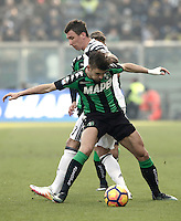 Calcio, Serie A: Sassuolo vs Juventus. Reggio Emilia, Mapei Stadium, 29 gennaio 2017. <br /> Juventus' Mario Mandzukic, left, and Sassuolo's Luca Antei fight for the ball during the Italian Serie A football match between Sassuolo and Juventus at Reggio Emilia's Mapei stadium, 29 January 2017.<br /> UPDATE IMAGES PRESS/Isabella Bonotto