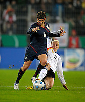 Anja Mittag (11) slide tackles Amy LePeilbet (6). US Women's National Team defeated Germany 1-0 at Impuls Arena in Augsburg, Germany on October 27, 2009.
