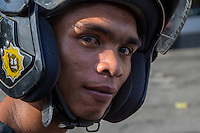 Bali, Indonesia.  Young Man on a Motorbike Wearing a Helmet.