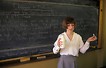 Female domestic science teacher Greenford High school Middlesex, holding up a glass pint milk bottle to demonstrate changes in Medicine and Louis Pasteur 1990s UK
