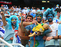 Uruguay supporters hold a baby doll in a Brazil kit