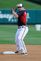 Infielder Phil Gosselin (11) of the Atlanta Braves works out before a Spring Training game against the New York Yankees on Wednesday, March 18, 2015, at Champion Stadium at the ESPN Wide World of Sports Complex in Lake Buena Vista, Florida. The Yankees won, 12-5. (Tom Priddy/Four Seam Images)