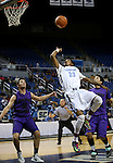 Canyon Springs' Shaquille Carr shoots over Spanish Springs defender Hunter Pinto during a Division I semi-final game in the NIAA basketball state tournament at Lawlor Events Center, in Reno, Nev., on Thursday, Feb. 27, 2014. Canyon Springs won 66-51. (Cathleen Allison/Las Vegas Review-Journal)