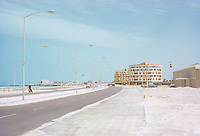 Abu Dhabi, UAE.  Corniche Street Scene. Persian (Arabian) Gulf off to left side. Abu Dhabi begins its modern development. Photographed March 1972.