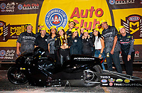 Nov 17, 2019; Pomona, CA, USA; NHRA pro stock motorcycle rider Jianna Salinas celebrates with crew and family after winning the Auto Club Finals at Auto Club Raceway at Pomona. Mandatory Credit: Mark J. Rebilas-USA TODAY Sports