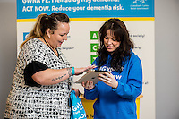 Friday 10 February 2017<br /> Pictured: Heidi Batter talks to Promotion staff member Louisa <br /> Re:Welsh Government Dementia Risk Prevention Roadshow at the BT building, Swansea, Wales, UK