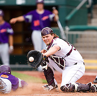 Luke Voit (30) of the Missouri State Bears cannot apply the tag at home in time during a game against the Evansville Purple Aces at Hammons Field on May 12, 2012 in Springfield, Missouri. (David Welker/Four Seam Images)