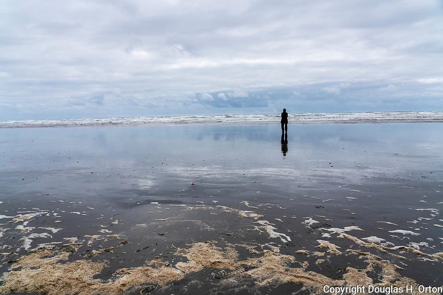 Senior woman, alone along Grayland Beach, Washington.  Grayland Beach Stae Park.