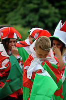 Wednesday 6th July 2016<br /> Welsh supporters watch the UEFA Euro 2016 Portugal v Wales semi-final on a giant screen in a fan zone in Swansea, Wales, UKMcKenzie Dyer aged 9