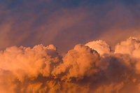 Sunset clouds in an 8.5X3 crop for graphic design.