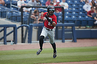 Freddy Zamora (23) of the Carolina Mudcats hustles towards home plate against the Kannapolis Cannon Ballers at Atrium Health Ballpark on June 13, 2021 in Kannapolis, North Carolina. (Brian Westerholt/Four Seam Images)