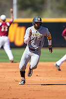 Justin Motley (6) of the Kennesaw State Owls hustles towards third base against the Winthrop Eagles at the Winthrop Ballpark on March 15, 2015 in Rock Hill, South Carolina.  The Eagles defeated the Owls 11-4.  (Brian Westerholt/Four Seam Images)
