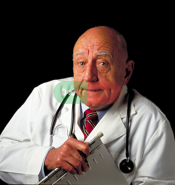 portrait of elder doctor with medical rounds patient chart
