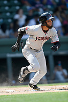 Center fielder Miguel Aparicio (5) of the Hickory Crawdads runs out a batted ball in a game against the Greenville Drive on Tuesday, April 30, 2019, at Fluor Field at the West End in Greenville, South Carolina. Hickory won, 5-4. (Tom Priddy/Four Seam Images)
