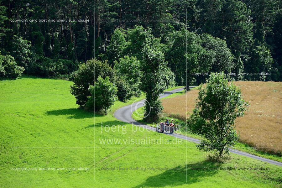 GERMANY Witzenhausen, forest and fields, old Porsche tractor on road / DEUTSCHLAND, Witzenhausen, Wald und Felder, alter Porsche Traktor