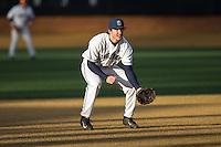Georgetown Hoyas third baseman Jake Kuzbel (14) on defense against the Delaware Blue Hens at Wake Forest Baseball Park on February 13, 2015 in Winston-Salem, North Carolina.  The Blue Hens defeated the Hoyas 3-0.  (Brian Westerholt/Four Seam Images)
