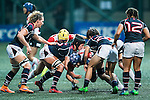 Amelie Odile Marie Seure of Hong Kong (l) competes against Japan during the Womens Rugby World Cup 2017 Qualifier match between Hong Kong and Japan on December 17, 2016 in Hong Kong, Hong Kong. Photo by Marcio Rodrigo Machado / Power Sport Images