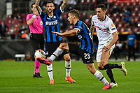 21st August 2020, Rheinenergiestadion, Cologne, Germany; Europa League Cup final Sevilla versus Inter Milan;  Sevillas Suso and Milan's Nicolo Barella challenge for the ball.