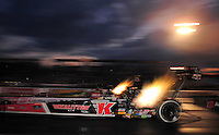 Sept. 30, 2011; Mohnton, PA, USA: NHRA top fuel dragster driver David Grubnic (near lane) races alongside Terry McMillen during qualifying for the Auto Plus Nationals at Maple Grove Raceway. Mandatory Credit: Mark J. Rebilas-
