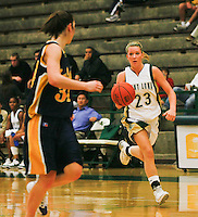 Freshman Amanda Franz of Point Loma Nazarene University moves past defenders from UW Eau Claire during the 2007 Surf N Slam Women?s Basketball Tournament at Golden Gymnasium on the PLNU campus in San Diego, Saturday December 29 2007.   PLNU played host to the tournament December 27, 28 and 29.  The eight team field included seven NCAA DIII schools; UW Stevens Point, UW Eau Claire, Carroll (WI), Gustavus Adolphus (MN), Ithaca (NY), Maryville (MO), Rivier (NH). Point Loma was the only NAIA school competing and defeated Wisconsin-Eau Claire 71-51 Saturday in Golden Gymnasium to take fourth place.  The tournament was won by Maryville who defeated Gustavus Aldolphus 68-64 in the final game on Saturday.